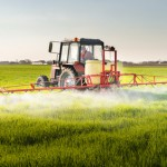 Tractor spraying wheat field with sprayer Dusan Kostic - Fotolia